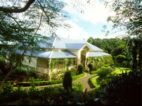 The Falls Rainforest Cottages - Whitsundays Accommodation